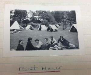 Photo of girls relaxing outside tents